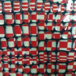 detail-cuir-damier-rouge-blanc-pastille-verni